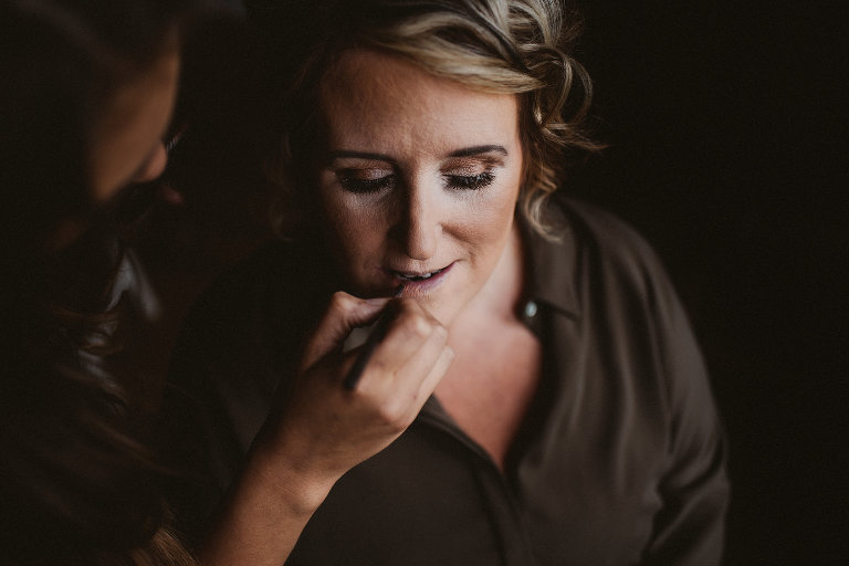 Bride having lipstick applied at Ashfield House